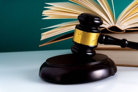 Gavel hammer and book with legally concept.