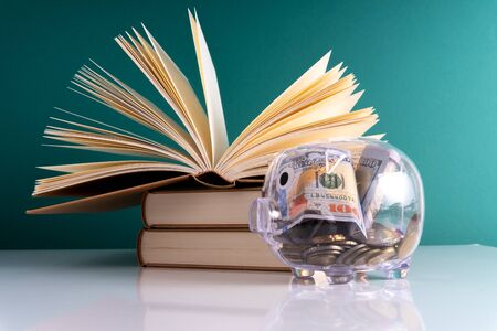 Piggybank and book with education concept.