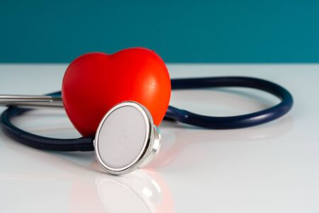 Stethoscope and heart toy with medical concept.