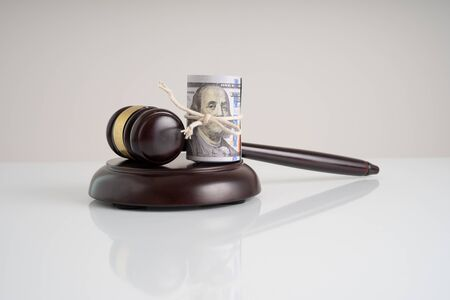 Gavel hammer and banknotes with financial concept.