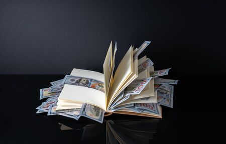 Banknotes and book with white background with financial concept. 写真素材 - 142147393