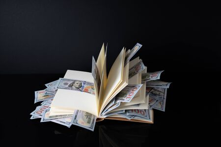 Banknotes and book with white background with financial concept. 写真素材 - 142147677