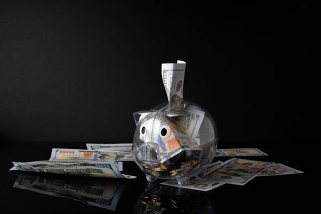 Piggy bank and black background with saving concept. 写真素材 - 142147630
