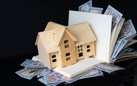 Banknotes and house with financial concept.