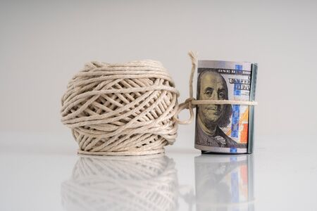 Money and a rope with financial concept.