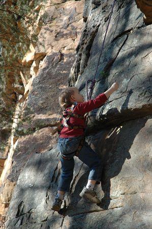 Child Enjoying Rock Climbing