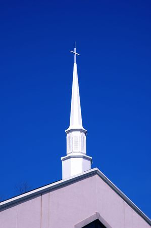 white steeple against a bright blue sky