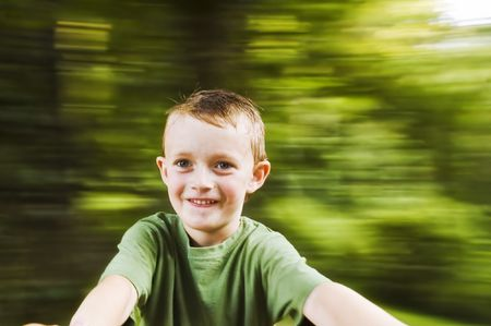 Spinning boy with blurred background and plenty of copy space Stock Photo