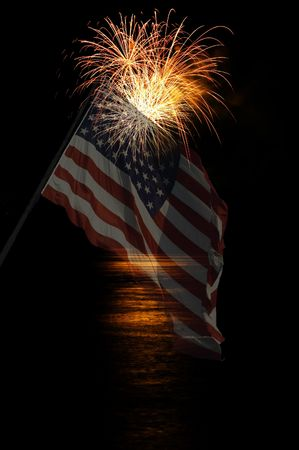 Orange yellow fireworks burst with reflection in the water Imagens