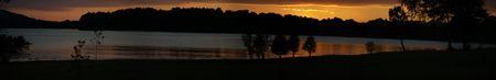 merged: merged image of lakeshore at sunset Stock Photo