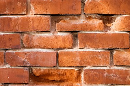 Aging highly textured brick wall suitable for background