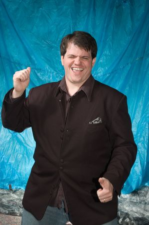 young overweight man posing in front of portrait backdrop Imagens