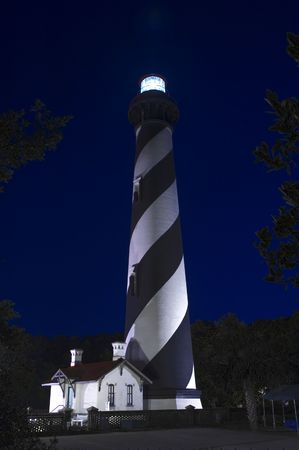 Lighthouse at St. Augustine at night with the beacon lit