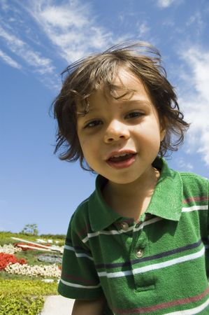 young boy smiling: Young boy smiling down at the camera Stock Photo