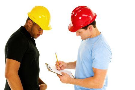 two construction men discuss project Imagens