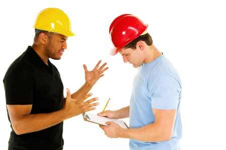 two construction men discuss project Archivio Fotografico