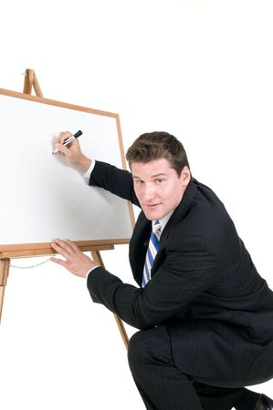 dry erase board: young business man writes on a white dry erase board