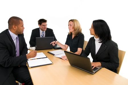 Two women and a two men sit at conference table at a business meeting 스톡 콘텐츠