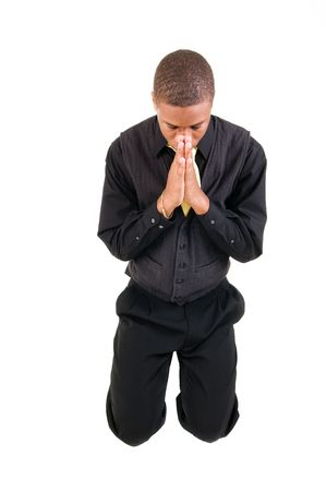 kneel: young man kneels and prays isolated on white background Stock Photo