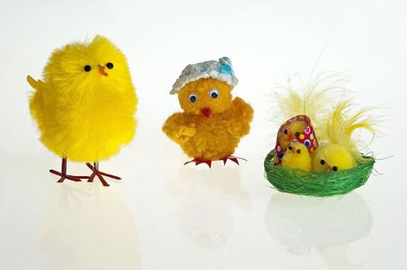 Easter background with decorative chickens in a nest