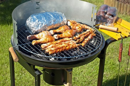 Grilling meat at summer weekend Stock Photo