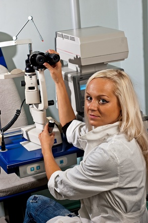 Young woman examining the eyesight in the opticians Stock Photo
