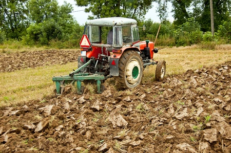ploughing field on old tractor in southern Poland photo