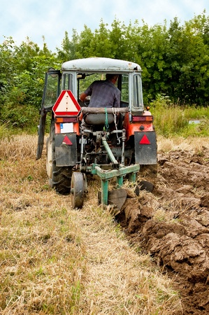 ploughing: ploughing field on old tractor in southern Poland