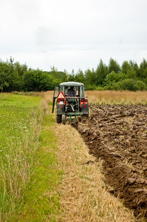 ploughing field: ploughing field on old tractor in southern Poland