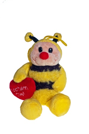 Plush bee with a heart for all the love on a white background Stock Photo