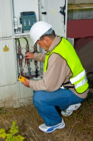 Electrician checking the condition of wiring and electricity meters for the electrical boxes. Stock Photo