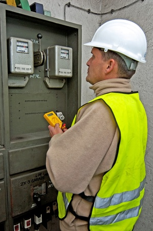 Electrician in studying the current-voltage switchgear and state electrical photo