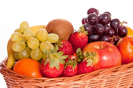 Various fresh ripe fruits placed in a wicker basket