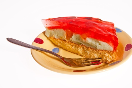 Dessert cake with jelly lying on the plate Stock Photo