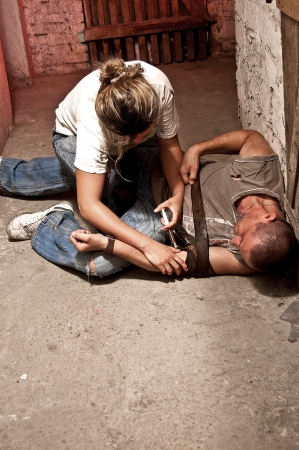 drug addict: Pair of drug addicts shaking in the basement Stock Photo