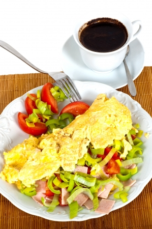 Omelet with vegetables and coffee for breakfast