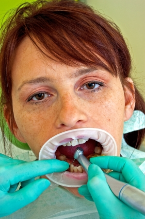 Dental treatment in a young woman in a dentist's office Stock Photo - 16880205