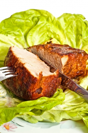 Roast pork in tomatoes on the white background Stock Photo
