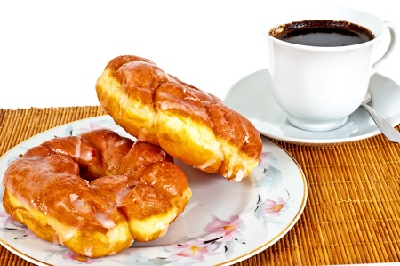 Delicious donuts with coffee for breakfast