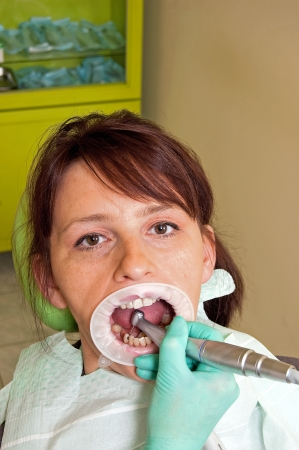 Dental treatment in a young woman in a dentists office Stock Photo