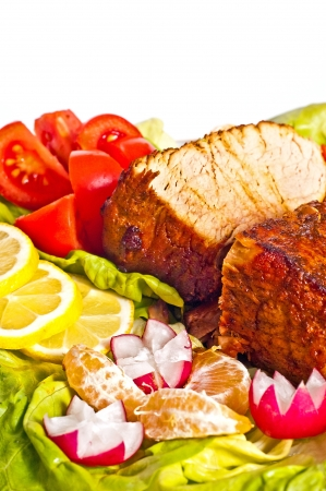 Roast with vegetables on a white background