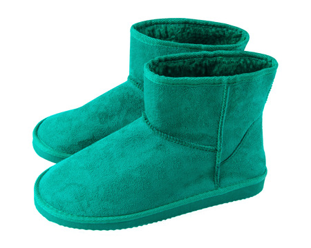 Sea color turquoise pair of short winter ugg boots isolated white
