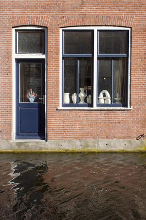 blue door and window above water canal Standard-Bild