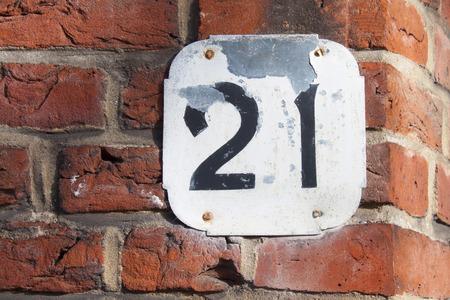 white house number twenty oner on brick wall