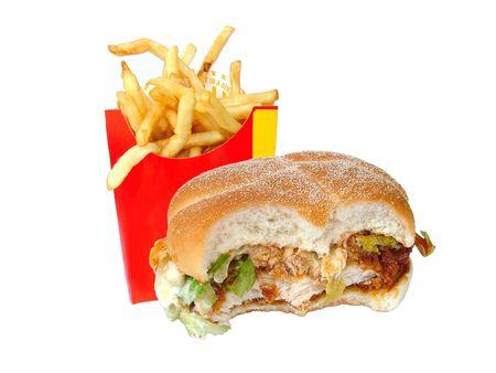 Bitten chicken burger and fries