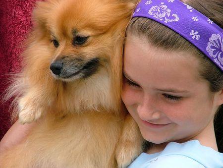 Girl dog cuddles