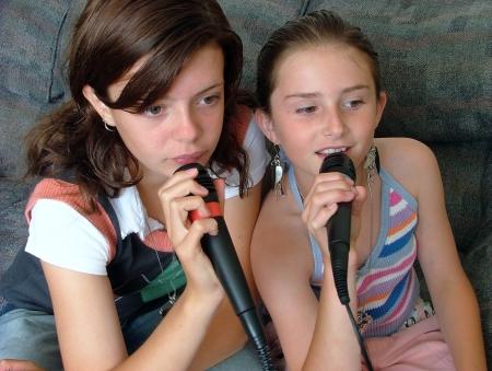 2 beautiful girls singing karaoke