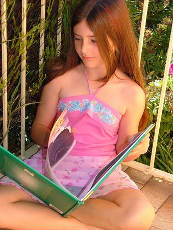 Girl reading book turning page Stock Photo - 390082