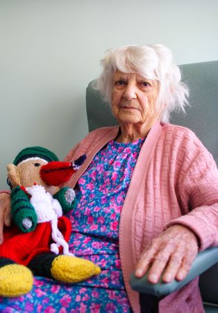 great grandmother: 94 year old senior citizen holding stuffed toy