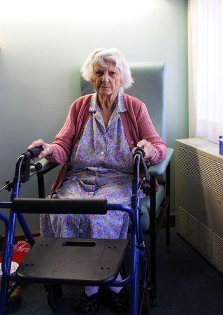 Senior citizen holding walking frame
